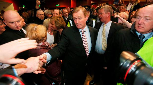 Taoiseach Enda Kenny is greeted by well-wishers as he arrives at the Royal Theatre in Castlebar, Co Mayo. Photo: PA