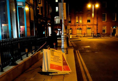 Labour posters being cleaned up after the party was cleaned out. Photo: Reuters