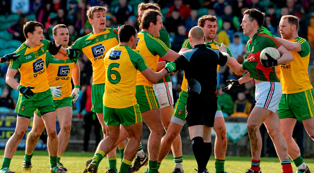 Donegal and Mayo players scuffle after the awarding of a Mayo penalty during yesterday's Allianz NFL Division 1 clash. Photo: Oliver McVeigh/Sportsfile