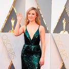 Actress Saoirse Ronan arrives on the red carpet for the 88th Oscars on February 28, 2016