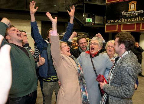 Katherine Zappone (centre right) celebrates with her wife Anne Louise Gilligan after winning a seat in Dublin South West. However, a recount was called last night. Photo: Colm O'Riordan