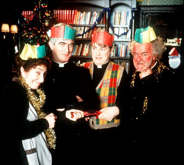 Frank Kelly, right, in a Father Ted Chrismas special with cast members Pauline Flynn, Dermot Morgan, and Ardal O'Hanlon.