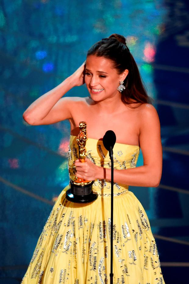 Actress Alicia Vikander accepts the Best Supporting Actress award for 'The Danish Girl' onstage during the 88th Annual Academy Awards at the Dolby Theatre on February 28, 2016 in Hollywood, California. (Photo by Kevin Winter/Getty Images)