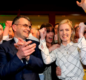 Fianna Fáil's Dara Calleary and Lisa Chambers celebrate her win at the expense of Taoiseach Enda Kenny's running mate, outgoing TD Michelle Mulherin, at the Castlebar Count Centre in Mayo. Photo: Gerry Mooney