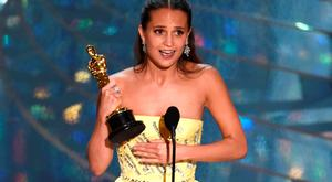 Alicia Vikander accepts the award for best actress in a supporting role for The Danish Girl at the Oscars on Sunday, Feb. 28, 2016, at the Dolby Theatre in Los Angeles. (Photo by Chris Pizzello/Invision/AP)