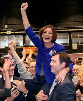 Fine Gael's Kate O'Connell celebrates her win in Dublin Rathdown with her husband Morgan and supporters. Photo: Damien Eagers