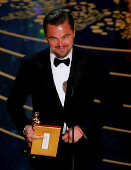 Leonardo DiCaprio accepts the Oscar for Best Actor for the movie