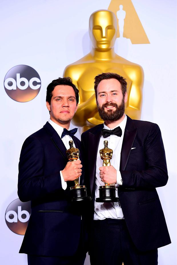Shan Christopher Ogilvie (left) Benjamin Cleary (right) with the Academy Award for Best Live Action Short Film in the press room of the 88th Academy Awards held at the Dolby Theatre in Hollywood, Los Angeles, CA, USA, February 28, 2016. PRESS ASSOCIATION Photo. Picture date: Sunday February 28, 2016.