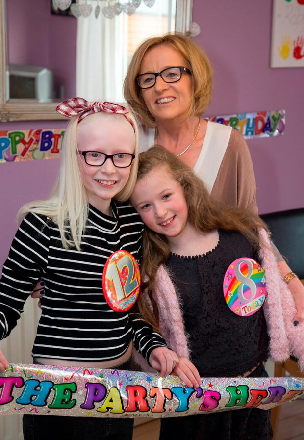 Leap Year Birthday Sisters, Lana (12) and Robyn (8), McKeon pictured with their Mum, Suzanne at their Blanchardstown home yesterday.