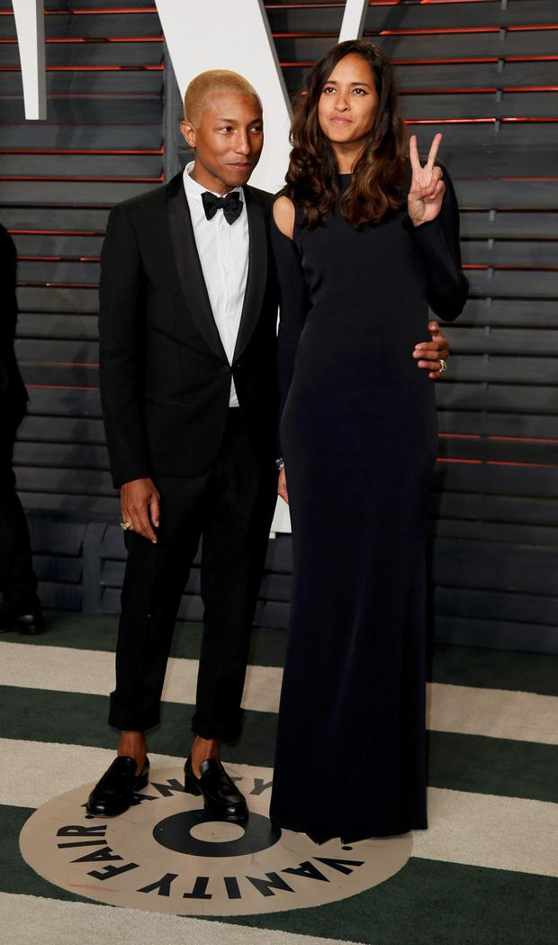 20a17bbea Musician Pharrell Williams and his wife Helen Lasichanh arrive at the  Vanity Fair Oscar Party in