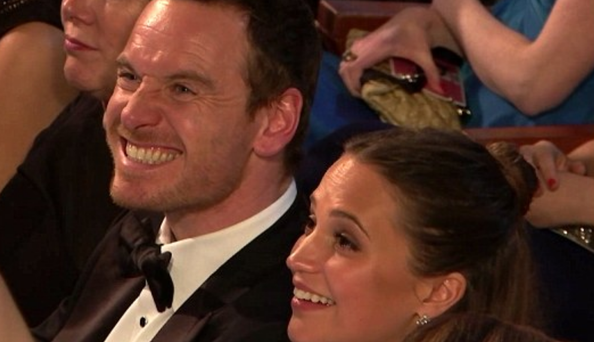 Michael Fassbender and Alicia Vikander share laugh at the Oscars before her win for Best Supporting Actress was announced.