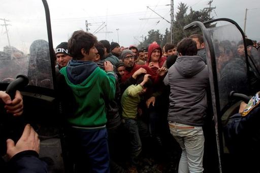 Stranded refugees and migrants are pushed back by Greek riot police after they tried to storm Macedonia from the Greek side of the border during a protest, near the Greek village of Idomeni, February 29, 2016