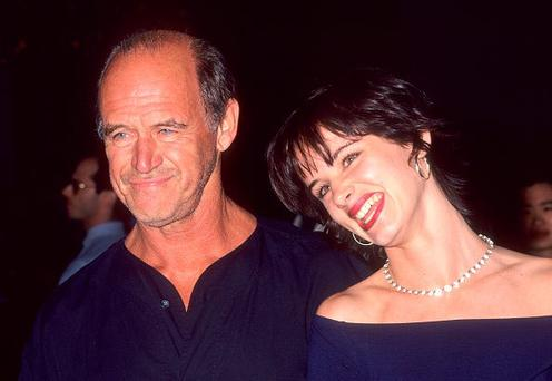 WEST HOLLYWOOD, CA - AUGUST 23: Actress Juliette Lewis and father actor Geoffrey Lewis attend the