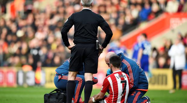 Southampton's Shane Long receives medical treatment against Chelsea