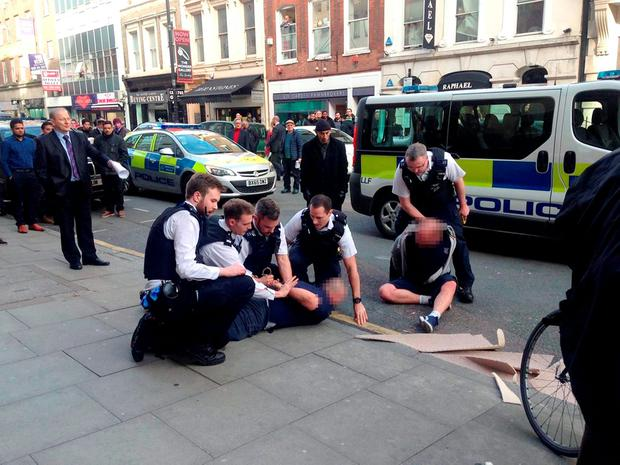 Two men being arrested after one was seen making threats with a knife and another allegedly assaulted a police constable in Hatton garden in Holborn Credit: Alex France/PA Wire