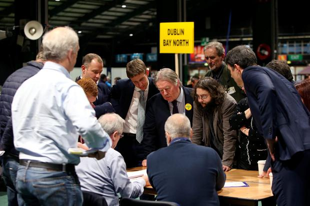 Independent candidates, Tommy Broughan, centre, looks on as votes are checked in the Dublin Bay North constituency at the RDS count centre. Picture credit; Damien Eagers