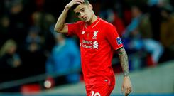 Liverpool's Philippe Coutinho and teammates dejected after losing the match