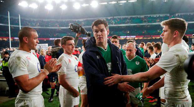 Ireland's Johnny Sexton (centre) is consoled by England's Owen Farrell (right) at the end of the 2016 RBS Six Nations match at Twickenham