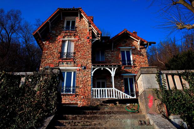 The Airbnb rental property where a decomposing body of a woman was found in the garden, in Palaiseau, south of Paris, France, Monday, Feb. 29, 2016. (AP Photo/Thibault Camus)
