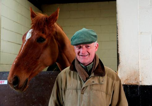 Trainer Willie Mullins with Annie Power at his stables yesterday. Photo: Brian Lawless/PA