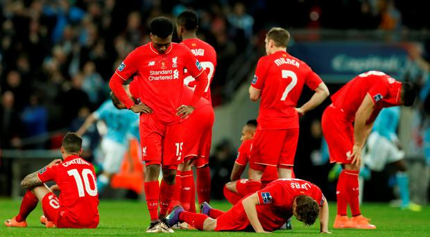Liverpool players are dejected after losing the penalty shootout