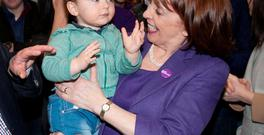Róisín Shortall of the left-leaning Social Democrats, who topped the poll in Dublin North West, celebrates with grand nephew Dara Baxter (2) at the count centre in Dublin's RDS. Photo: Collins Dublin, Gareth Chaney