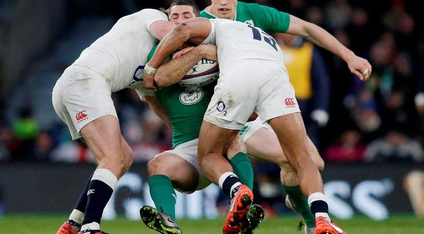 England duo Owen Farrell and Jonathan Joseph tackle Ireland full-back Rob Kearney. Photo: Henry Browne/Reuters