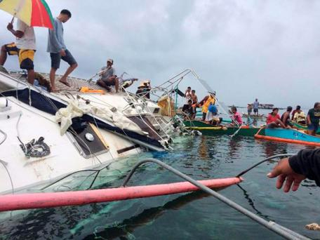 Fishermen recover the yacht off Barobo in the Philippines, in which the mummified sailor was discovered