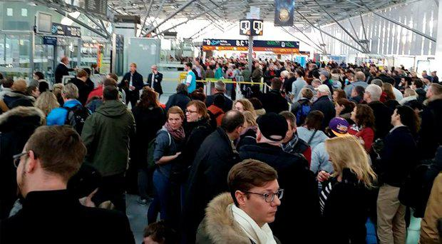 Passengers seen evacuating the Cologne airport terminals Marco Tarsia