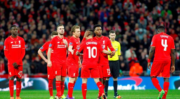 Liverpool's Philippe Coutinho looks dejected with Daniel Sturridge after missing in the penalty shootout