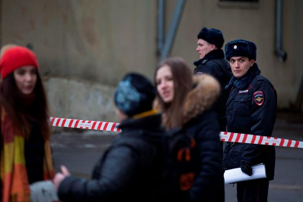 Russian police officers secure an area near to a subway station in Moscow on Monday, Feb. 29, 2016. Russian news agencies report that police have arrested a woman who was waving the severed head of a small child outside a Moscow subway station. The Investigative Committee released a statement saying a woman was arrested Monday on suspicion of killing a child aged 3 or 4 in an apartment near the metro station in northwestern Moscow and then setting the apartment on fire