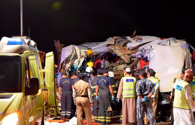 A picture made available by Omani police shows the site of an accident that occured in the early hours of March 01, 2016 on the road between Ibri and Fahud in western Oman, involving a truck and a bus that was carrying passengers from Salalah, southwest of the Gulf sultanate, to Dubai in the United Arab Emirates