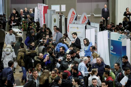 Refugees fills looking for employment and training possibilities at a jobs fair in Berlin Credit: Carsten Koall (Getty Images)