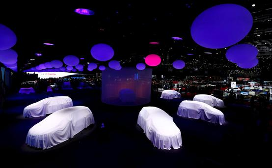 Covered cars are pictured at the stand of Renault at the 86th International Motor Show in Geneva.