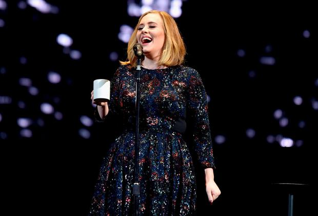 Adele performing on stage at the SSE Arena in Belfast Credit: Gareth Cattermole (Getty Images)
