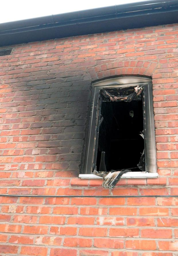 The upstairs window of a house where a 49-year-old woman was doused with petrol before she was set alight. Credit: Greater Manchester Police/PA Wire