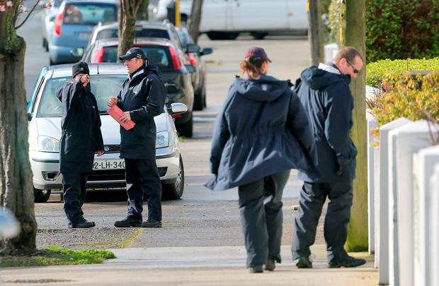 Gardaí search gardens of houses near the scene of the shooting dead of Vincent Ryan on McKee Road, Finglas. Picture Colin Keegan, Collins Dublin.