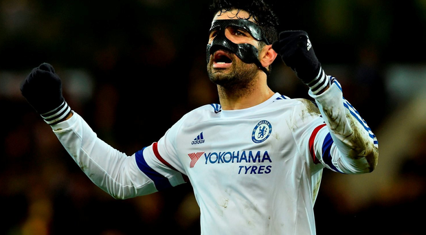 Chelsea's Brazilian-born Spanish striker Diego Costa celebrates at the end of the English Premier League football match between Norwich City and Chelsea at Carrow Road in Norwich, eastern England, on March 1, 2016. / AFP / BEN STANSALL /