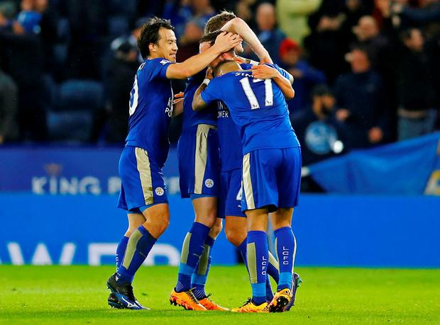 Danny Drinkwater celebrates with Shinji Okazaki, Danny Simpson and Andy King after scoring the first goal for Leicester City