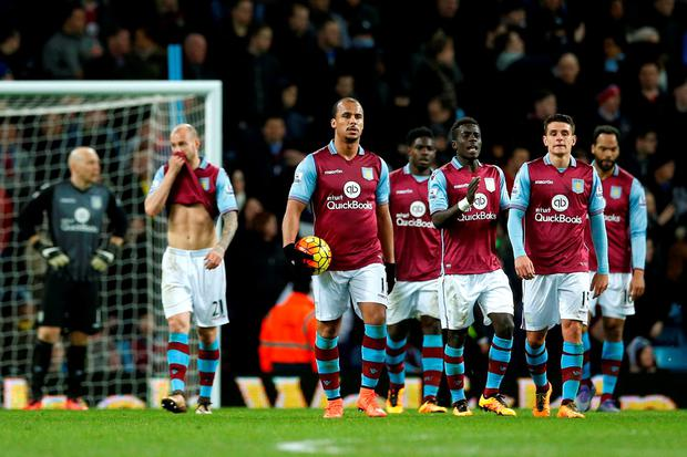 Aston Villa's Gabriel Agbonlahor, Ashley Westwood and Aly Cissokho are dejected after Everton's third goal