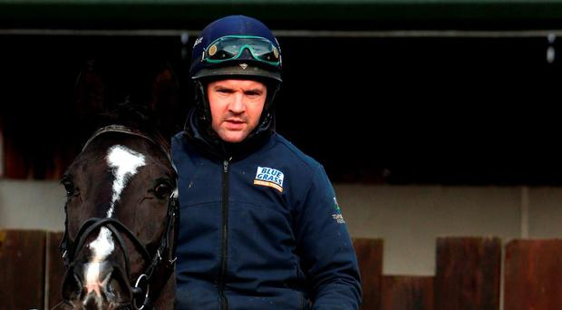 Gordon Elliott (right) with Don Cossack and rider Simon McGonagle during a press day at his Cullentra House stables in Longwood, Co Meath (Brian Lawless/PA Wire)