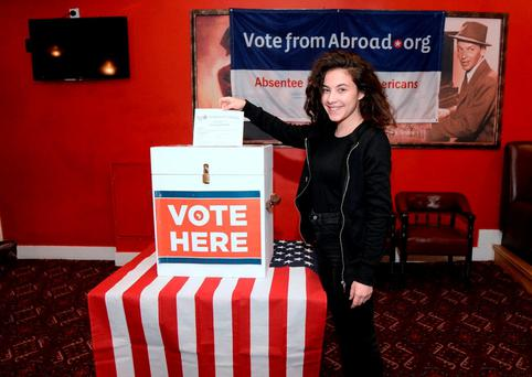 Lydia Di Perrio from Massachusetts, but living in Swords in Dublin, casts her vote for the US Presidential Primary elections, operated by Democrats Abroad in the Arlington Hotel, Dublin. Photo: Caroline Quinn