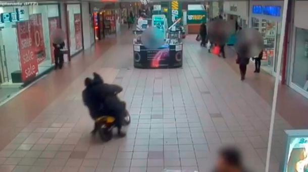 CCTV still issued by Merseyside Police of James Kinsella, 20, riding an off-road motorbike through a busy shopping centre Credit: Merseyside Police/PA Wire