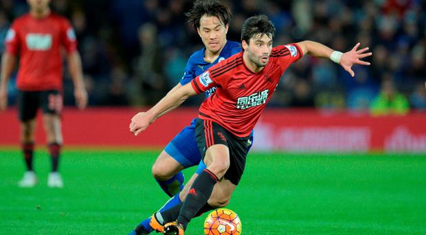 West Brom's Claudio Yacob gets away from Leicester City's Shinji Okazaki: Oli Scarff/AFP/Getty Images