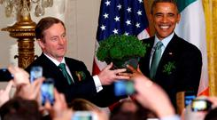 Taoiseach Enda Kenny presents a bowl of shamrocks to US President Barack Obama on St Patrick's Day last year. Photo: Reuters