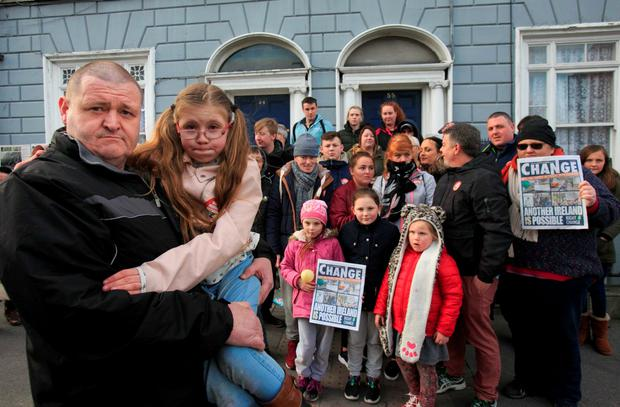 Mark Richardson and his daughter Molly (8) who are facing eviction during a protest in solidarity over the proposed eviction of 13 families (Collins)
