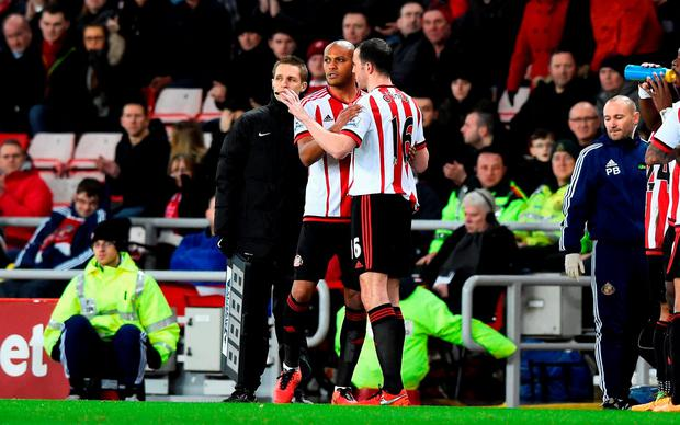 John O'Shea of Sunderland is replaced by Younes Kaboul during the Barclays Premier League match between Sunderland and Crystal Palace