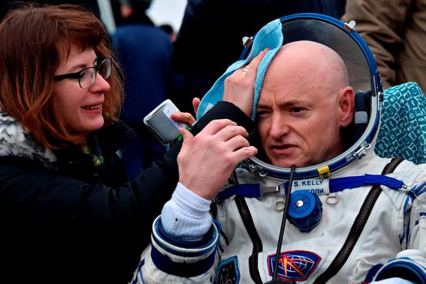 U.S. astronaut Scott Kelly is assisted by ground personnel shortly after landing near the town of Dzhezkazgan (Zhezkazgan), Kazakhstan, March 2, 2016