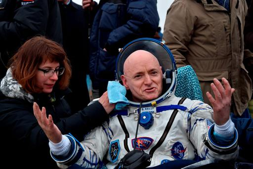 International Space Station (ISS) crew member Scott Kelly of the U.S. reacts after landing near the town of Dzhezkazgan, Kazakhstan, on Wednesday, March 2, 2016