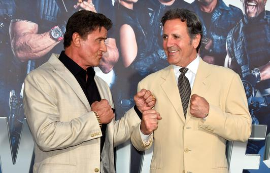 HOLLYWOOD, CA - AUGUST 11: Actor/writer Sylvester Stallone (L) and actor Frank Stallone attend the premiere of Lionsgate Films'